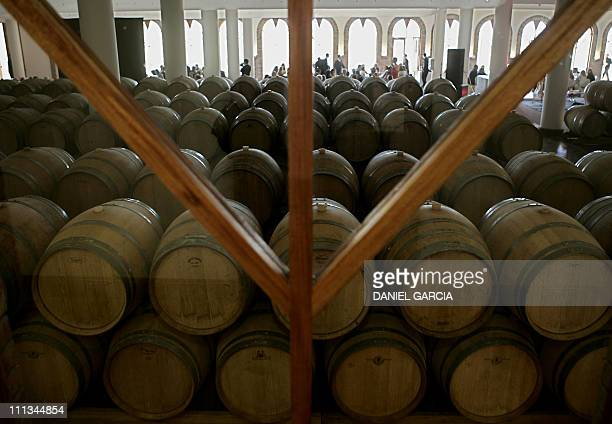 Barrels of wine beside the room while a luncheon was offered after Baroness Nadine de Rothschild and French businessman Laurent Dassault cut the...
