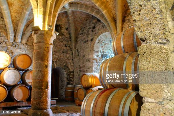 barrels on floor in old building - vaud canton stock pictures, royalty-free photos & images