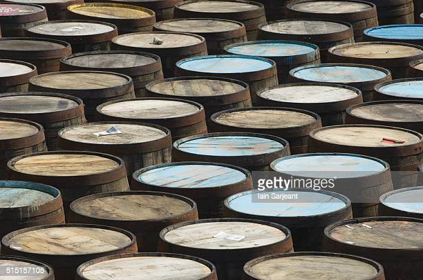 barrels outside a whisky distillery. - aberdeenshire stock pictures, royalty-free photos & images