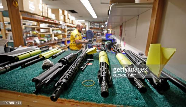 AR15 barrels sit on a shelf as a worker assembles an AR15 rifle at Delta Team Tactical in Orem Utah on March 20 2020 Gun stores in the US are...