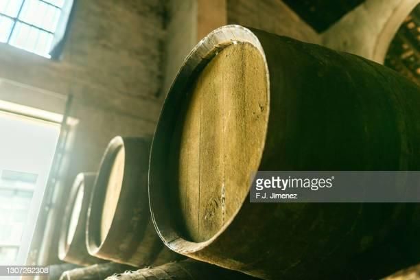 barrels stacked in the winery - ヘレスデラフロンテラ ストックフォトと画像