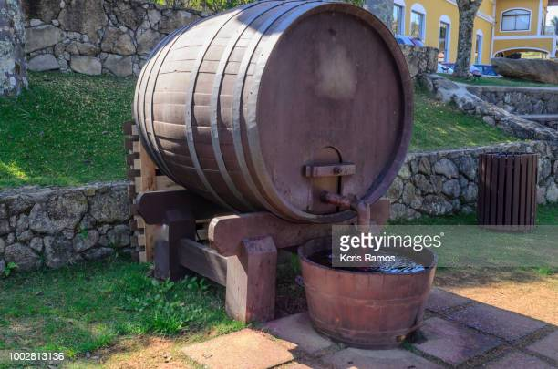 barrel-shaped source of wine, with wine, on sunny day in July 2108, in São Roque, São Paulo, Brazil