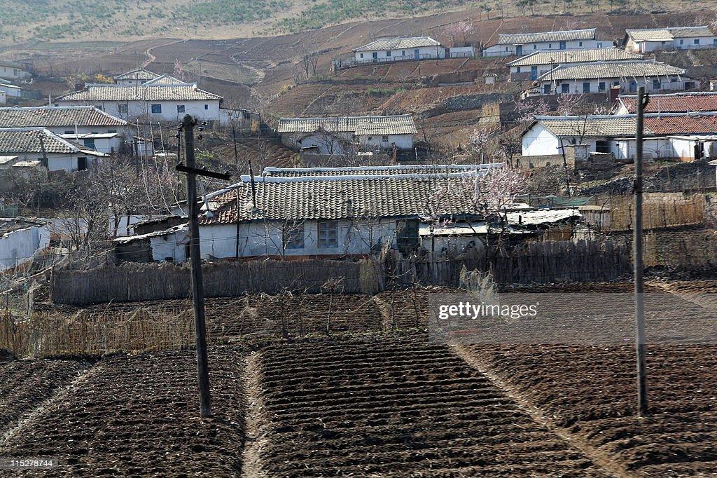 Barren and dry farmland and farm houses : News Photo
