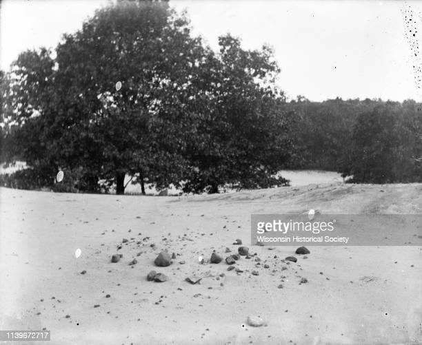 A barren area of sandy soil and rocks identified as the site of an Indian village near Okee Lodi Wisconsin 1907