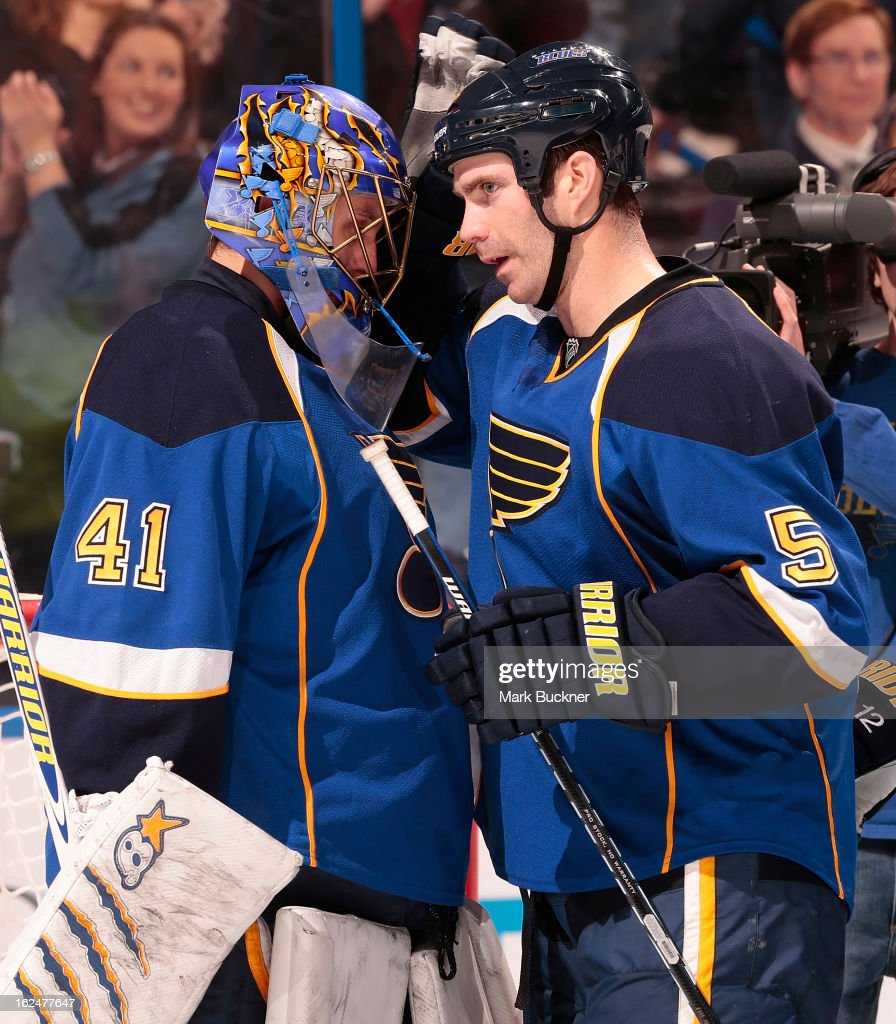 Barret Jackman #5 of the St. Louis Blues congratulates goalie Jaroslav Halak #41 after a victory over the Columbus Blue Jackets in an NHL game on February 23, 2013 at Scottrade Center in St. Louis, Missouri. Jackman was playing in his 616th game as a blue, an all time high for defenseman on the team.