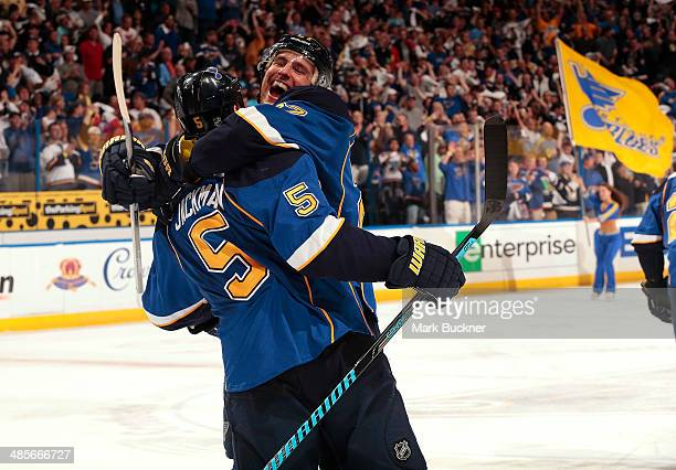 Barret Jackman of the St Louis Blues is congratulated by Alex Pietrangelo after scoring the game winning goal against the Chicago Blackhawks in Game...