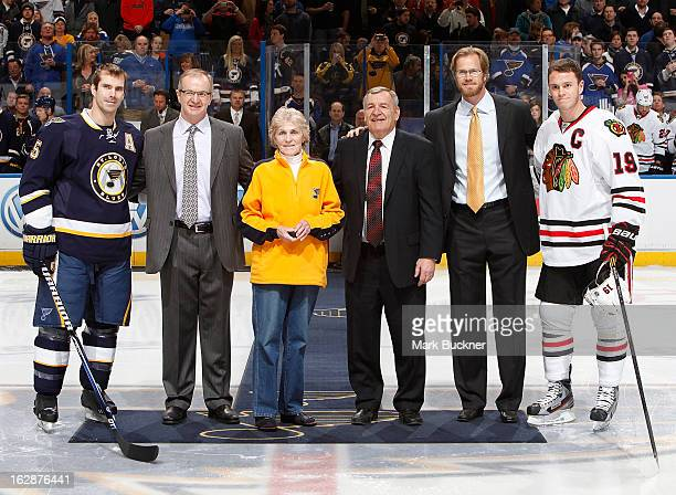 Barret Jackman of the St Louis Blues is joined by former Blues defensemen Al MacInnis Helen Plager wife of former Blues great Barclay Plager Bobby...