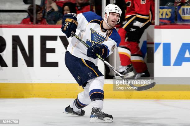 Barret Jackman of the St. Louis Blues passes the puck against the Calgary Flames on March 20, 2009 at Pengrowth Saddledome in Calgary, Alberta,...