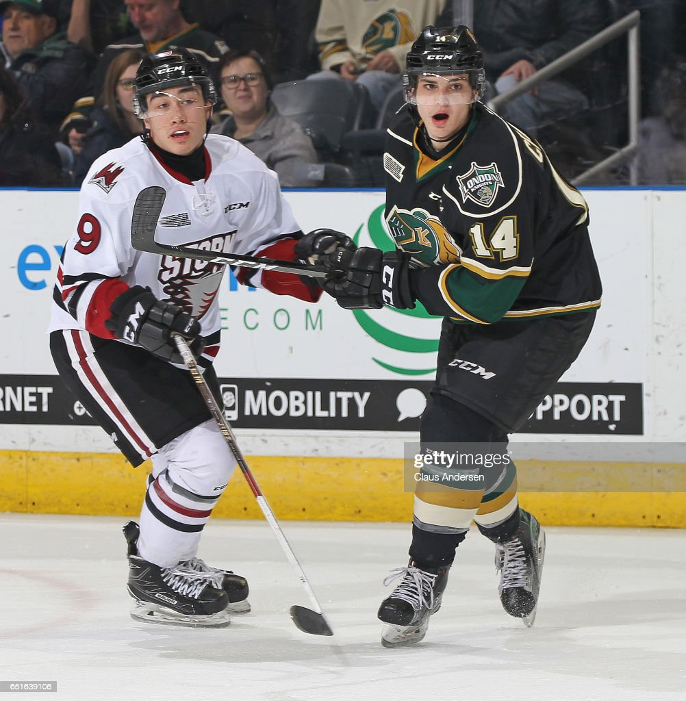 Barret Kirwin #9 of the Guelph Storm skates against Brandon Crawley #14 of the London Knights during an OHL game at Budweiser Gardens on March 9, 2017 in London, Ontario, Canada. The Knights defeated the Storm 8-2.