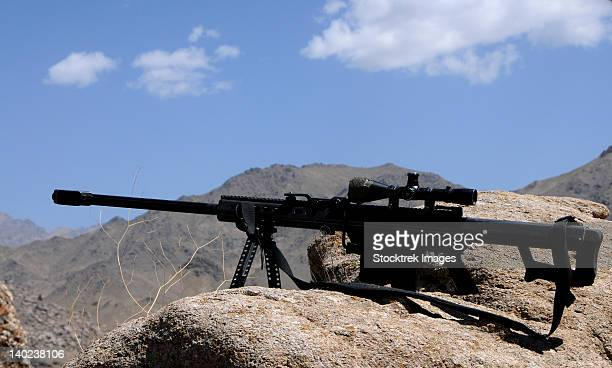 A Barrett .50-caliber M107 Sniper Rifle sits atop an observation point in Afghanistan.