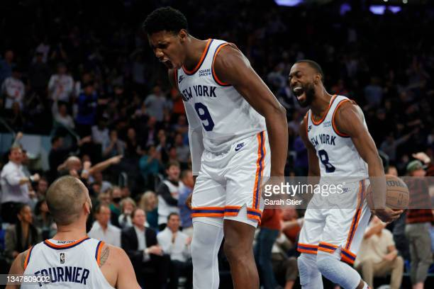 Barrett and Kemba Walker react with Evan Fournier of the New York Knicks during the second half against the Boston Celtics at Madison Square Garden...