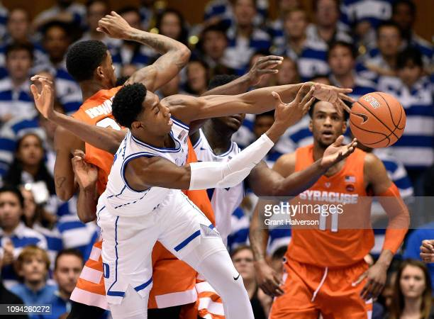Barrett and Zion Williamson of the Duke Blue Devils battle Frank Howard of the Syracuse Orange for a rebound during the first half of their game at...