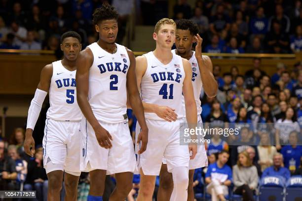 Barrett Cam Reddish Jack White and Marques Bolden of the Duke Blue Devils look on during their game against the Ferris State Bulldogs at Cameron...