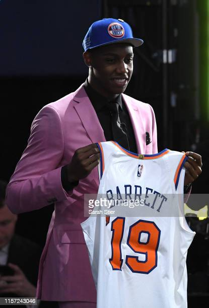 Barrett holds up a New York Knicks jersey after being drafted with the third overall pick by the New York Knicks during the 2019 NBA Draft at the...