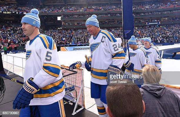 Barrett Jackman of the St Louis Blues and Bernie Federko of the St Louis Blues take the ice prior to a game between the St Louis Blues and the...