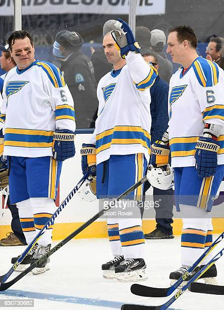 Barrett Jackman of the St Louis Blues salutes fans during player introductions prior to a game between the St Louis Blues and the Chicago Blackhawks...