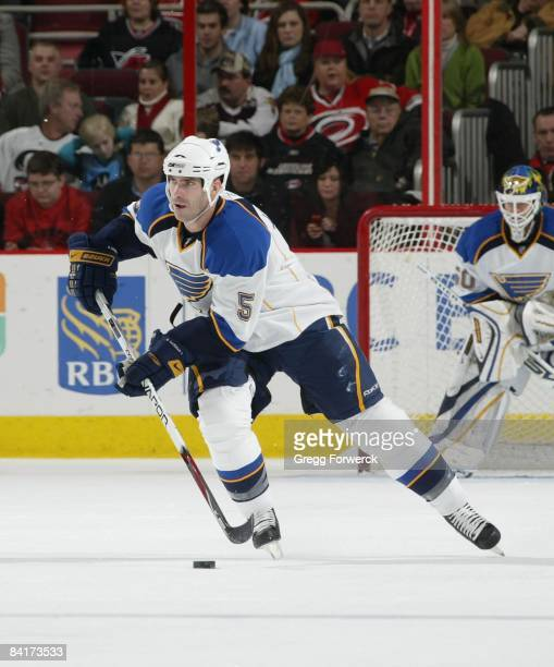 Barrett Jackman of the St Louis Blues skates with the puck during a NHL game against the Carolina Hurricanes on January 2 2009 at RBC Center in...