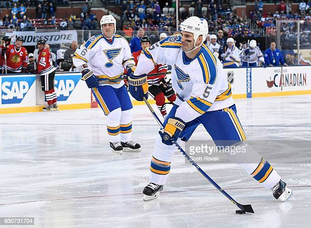 Barrett Jackman of the St Louis Blues takes a shot against the Chicago Blackhawks during the 2017 Bridgestone NHL Winter Classic Alumni Game at Busch...