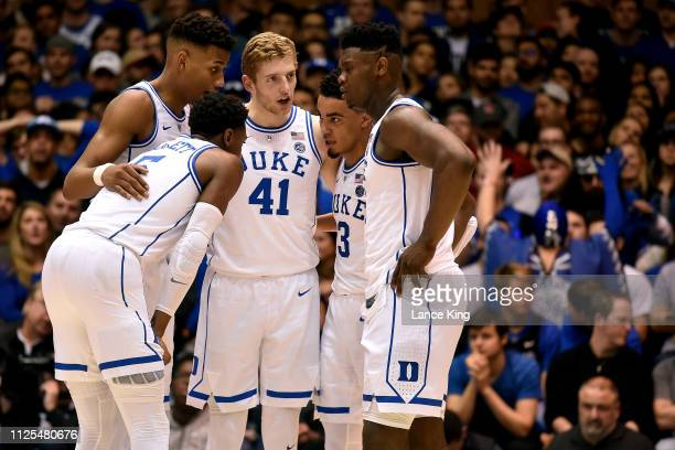 Barrett Javin DeLaurier Jack White Tre Jones and Zion Williamson of the Duke Blue Devils huddle during their game against the North Carolina State...