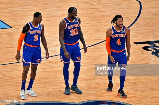 Barrett, Julius Randle and Derrick Rose of the New York Knicks walk on the court during the second half against the Memphis Grizzlies at FedExForum...