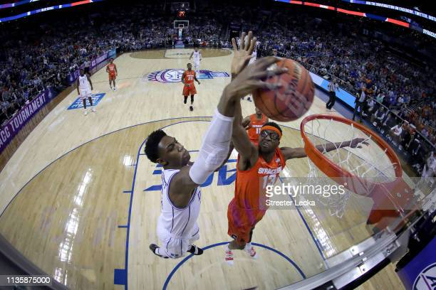 Barrett of the Duke Blue Devils and Paschal Chukwu of the Syracuse Orange drive to the rim during their game in the quarterfinal round of the 2019...