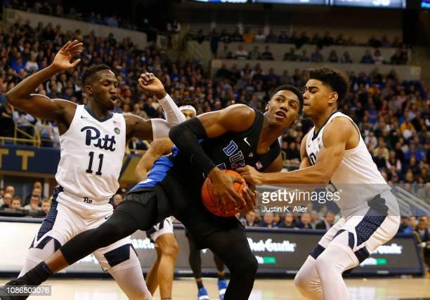Barrett of the Duke Blue Devils battles for the ball against Malik Ellison of the Pittsburgh Panthers and Sidy N'Dir of the Pittsburgh Panthers at...