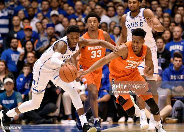 Barrett of the Duke Blue Devils battles Tyus Battle of the Syracuse Orange for a loose ball during the first half of their game at Cameron Indoor...