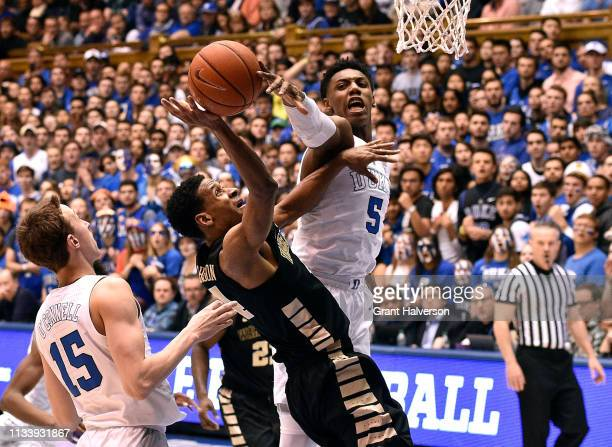 Barrett of the Duke Blue Devils blocks a shot by Torry Johnson of the Wake Forest Demon Deacons during the second half of their game at Cameron...