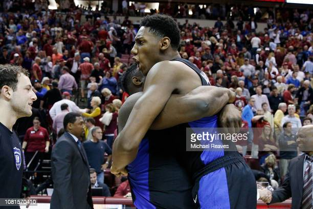 Barrett of the Duke Blue Devils celebrates with Zion Williamson after defeating the Florida State Seminoles at Donald L Tucker Center on January 12...