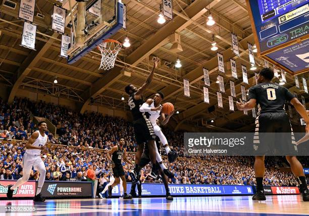 Barrett of the Duke Blue Devils drives against Ikenna Smart of the Wake Forest Demon Deacons during the second half of their game at Cameron Indoor...