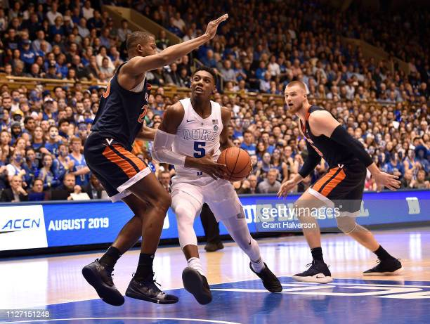 Barrett of the Duke Blue Devils drives against Kody Stattmann of the Virginia Cavaliers during their game at Cameron Indoor Stadium on January 19...