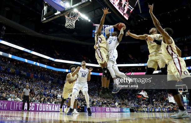 Barrett of the Duke Blue Devils drives to the basket against Mfiondu Kabengele of the Florida State Seminoles during the championship game of the...