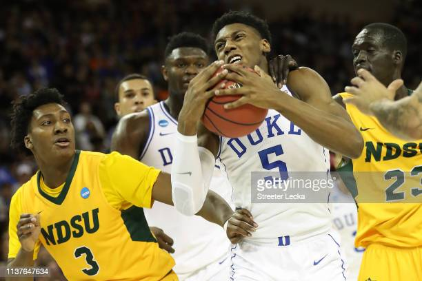 Barrett of the Duke Blue Devils drives to the basket against Tyree Eady of the North Dakota State Bison in the first half during the first round of...