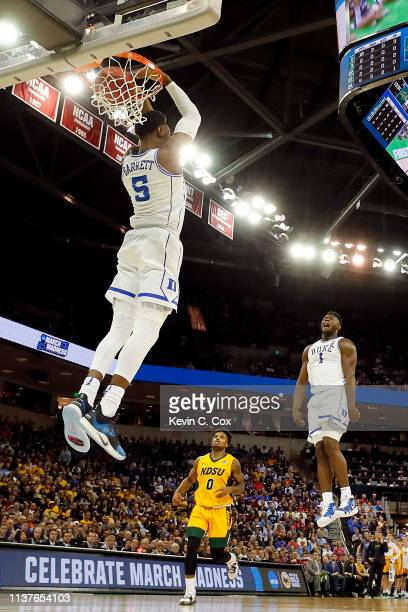 Barrett of the Duke Blue Devils dunks the ball as teammate Zion Williamson celebrates against the North Dakota State Bison in the second half during...