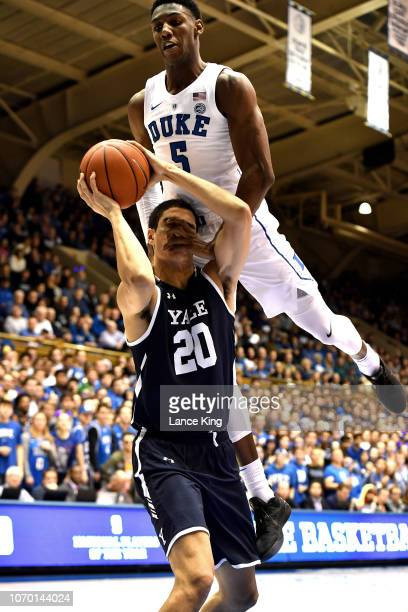 Barrett of the Duke Blue Devils fouls Paul Atkinson of the Yale Bulldogs in the first half at Cameron Indoor Stadium on December 8 2018 in Durham...