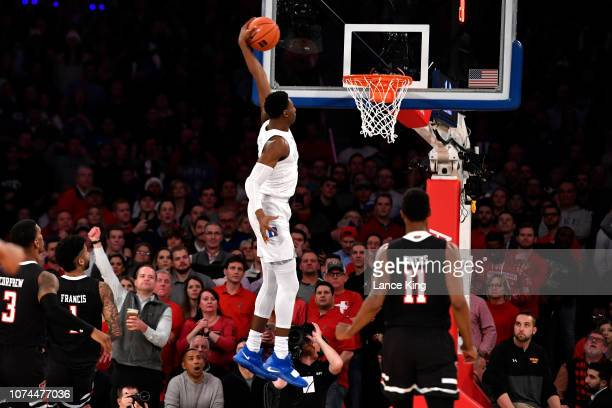 Barrett of the Duke Blue Devils goes up for a dunk against the Texas Tech Red Raiders in the first half at Madison Square Garden on December 20 2018...
