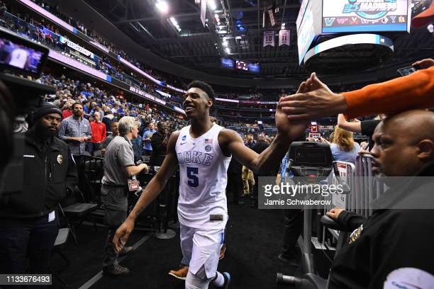 Barrett of the Duke Blue Devils high fives a fan after defeating Virginia Tech Hokies in the third round of the 2019 NCAA Men's Basketball Tournament...