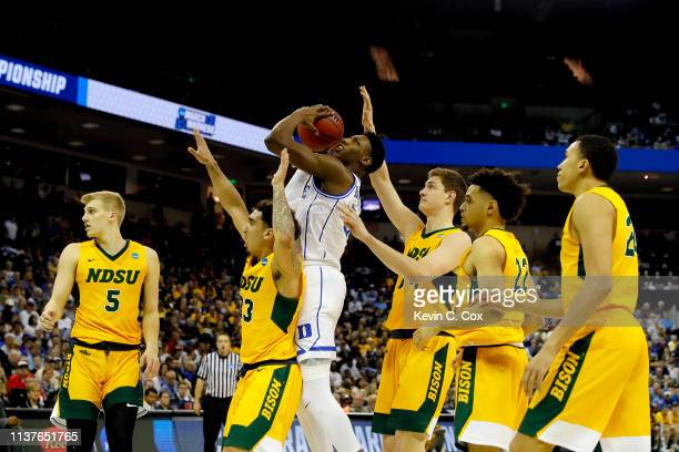 Barrett of the Duke Blue Devils is fouled by Jordan Horn of the North Dakota State Bison on his way to the basket in the second half during the first...