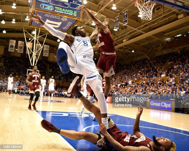 Barrett of the Duke Blue Devils is fouled by Ky Bowman of the Boston College Eagles during a shot attempt in the second half at Cameron Indoor...