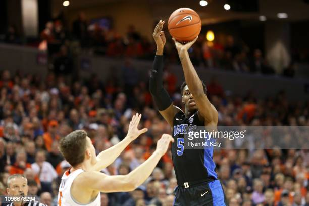Barrett of the Duke Blue Devils shoots over Kyle Guy of the Virginia Cavaliers in the first half during a game at John Paul Jones Arena on February 9...