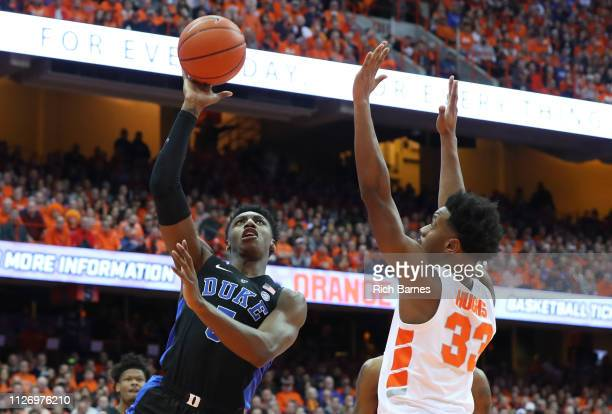 Barrett of the Duke Blue Devils shoots the ball around Elijah Hughes of the Syracuse Orange during the first half at the Carrier Dome on February 23...