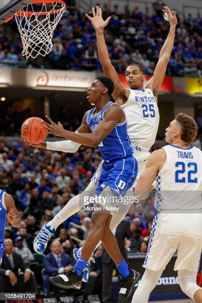 Barrett of the Duke Blue Devils shoots the ball as PJ Washington of the Kentucky Wildcats defends at Bankers Life Fieldhouse on November 6 2018 in...