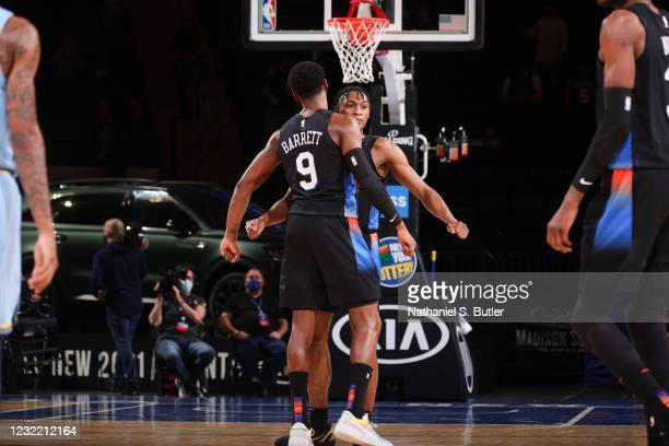 Barrett of the New York Knicks chest bumps Immanuel Quickley of the New York Knicks during the game against the Memphis Grizzlies on April 9, 2021 at...