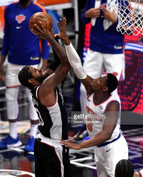 Barrett of the New York Knicks defends against a jump shot by Paul George of the Los Angeles Clippers during the second half of the game at Staples...