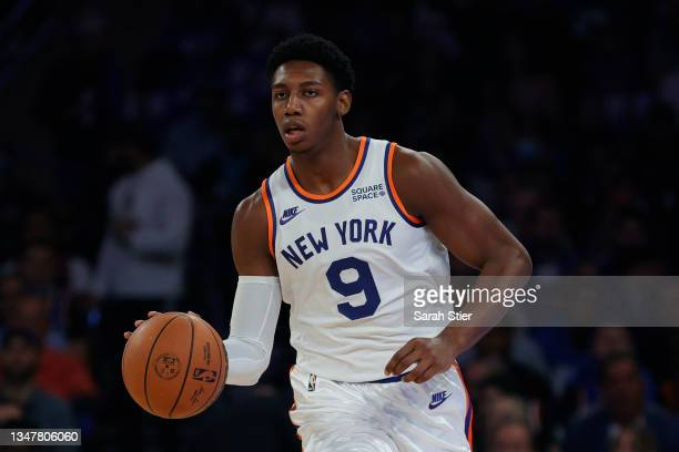 Barrett of the New York Knicks dribbles during the first half against the Boston Celtics at Madison Square Garden on October 20, 2021 in New York...