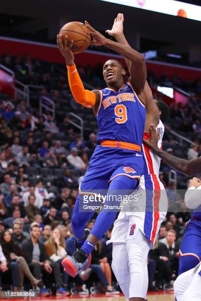 Barrett of the New York Knicks drives to the basket against Andre Drummond of the Detroit Pistons during the first half at Little Caesars Arena on...