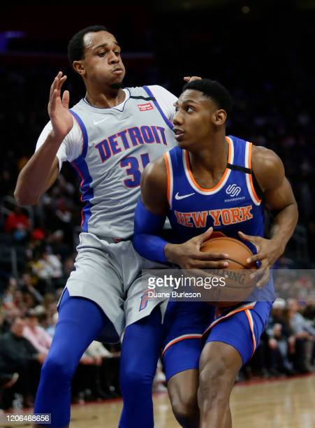 Barrett of the New York Knicks goes to the basket against John Henson of the Detroit Pistons during the first half at Little Caesars Arena on...