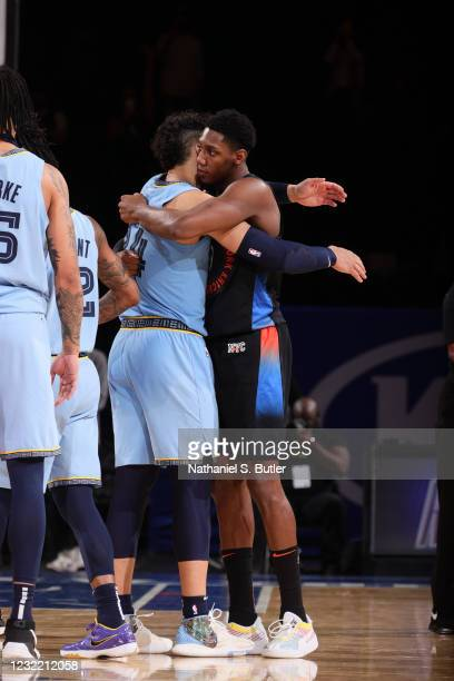Barrett of the New York Knicks hugs Dillon Brooks of the Memphis Grizzlies after the game on April 9, 2021 at Madison Square Garden in New York City,...