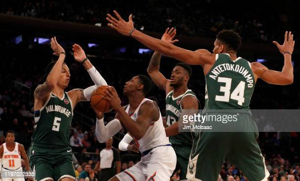 RJ Barrett of the New York Knicks in action against DJ Wilson Thanasis Antetokounmpo and Giannis Antetokounmpo of the Milwaukee Bucks at Madison...
