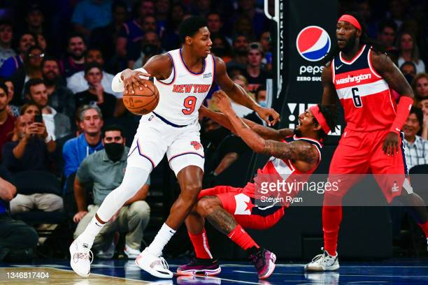 Barrett of the New York Knicks is called for a charge on Bradley Beal of the Washington Wizards during a preseason game at Madison Square Garden on...